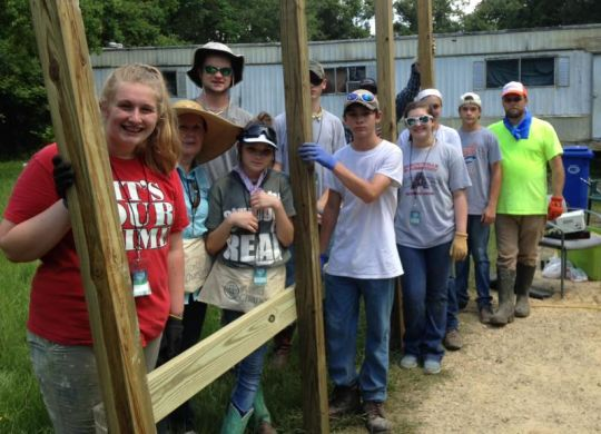 World Changers youth work with Fuller Center to lift flood-damaged community