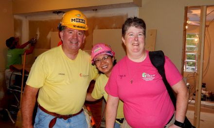 "Karen Warkentien (right) poses with friends Eddie and Nicetas Proctor at the Legacy Build. Better known as ""Toolie,"" Karen started as a volunteer but now also serves as a member of The Fuller Center's International Board of Directors. We asked her about why it is important for her to continue volunteering while also serving as a board member."
