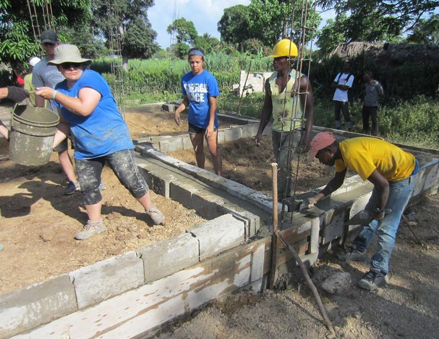 Fuller Center Global Builders volunteers work alongside local laborers.