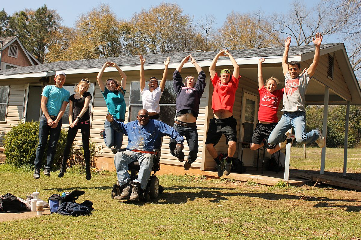 Fuller Center homeowner and volunteer Thad Harris with a group of student builders from Ohio State University.