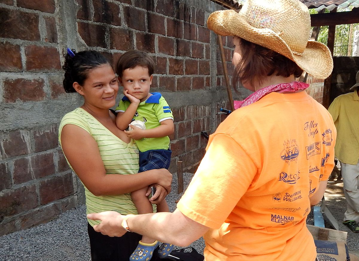 Tamara Danel visits with homeowners during a Global Builders trip to Nicaragua.